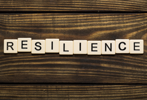 resilience spelled in letters on wood background