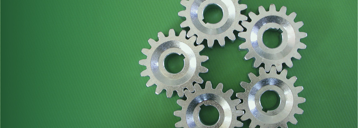 five silver cogs on a green background