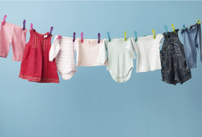 childrens clothes hanging on washing line