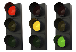 3 traffic lights showing red, amber and green