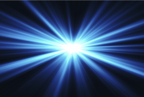 Bright blue rays of light coming from a distant focal point on a dark background