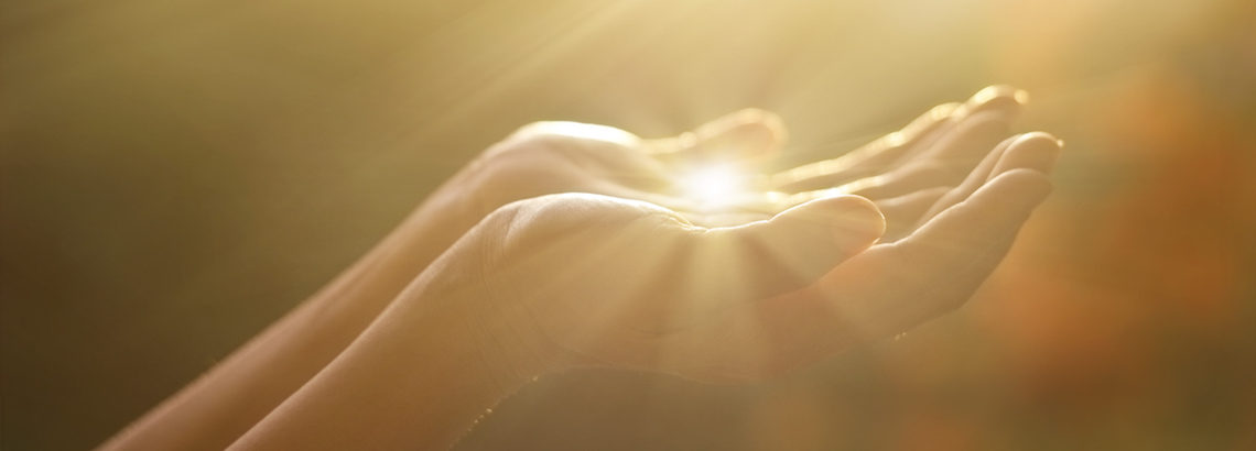 cupped hands holding light