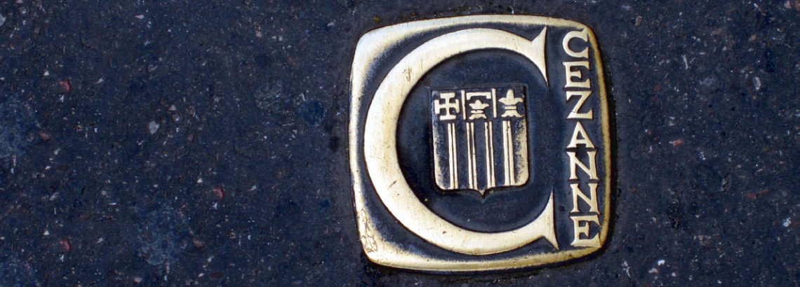 Photograph of a metal ground waymarker for a walking trail about Cezanne in Aix-en-Provence
