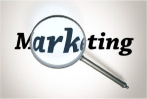 Word 'Marketing' written in black on a white background with a magnifying glass above it